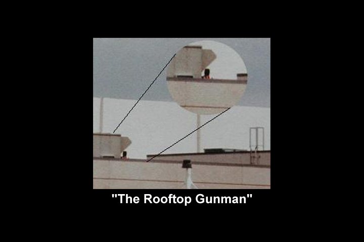 Image of a photograph of an apparent man or woman with a gun on the roof of CHS during the attack